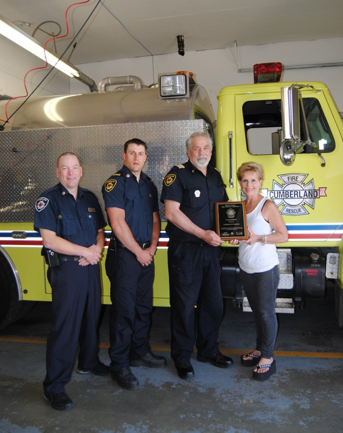 Fire Commissioners Office Recognition with Firefighter Mike Ellis, Captain Jesse French, Chief Mike Williamson and business owner Jean Cameron